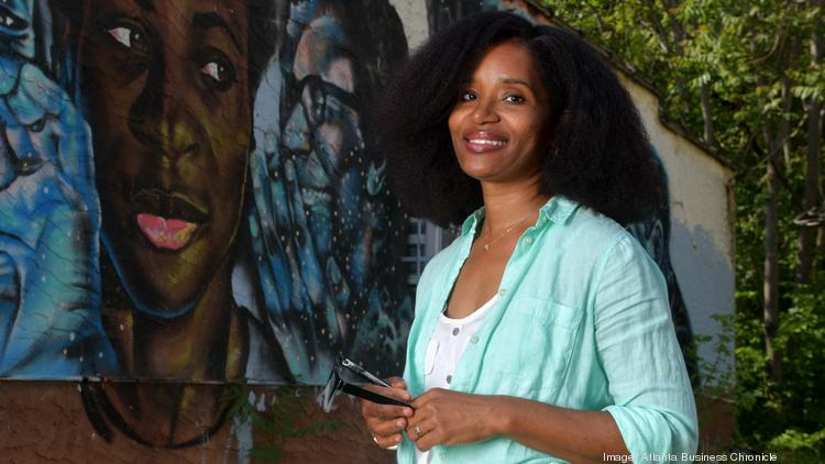 Marddy's founder Keitra Bates Standing in front of a mural